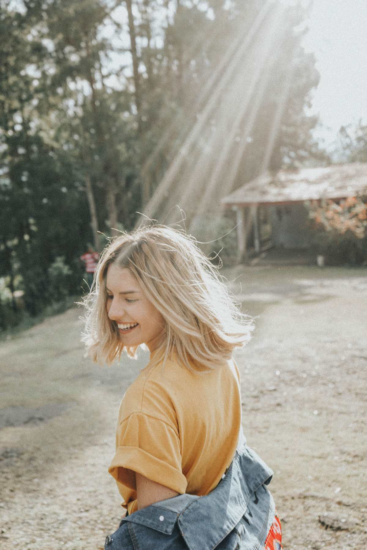 Girl smiling and twirling in the sun