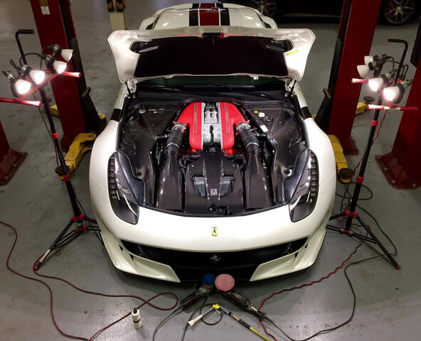 Ferrari during ceramic coating and paint protection film service in the Proficient X shop in Orlando FL