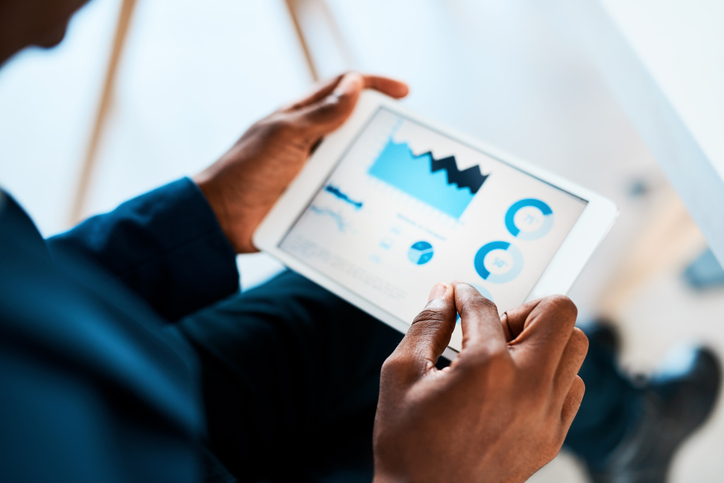 Measuring success using an analytics dashboard on a mobile device.