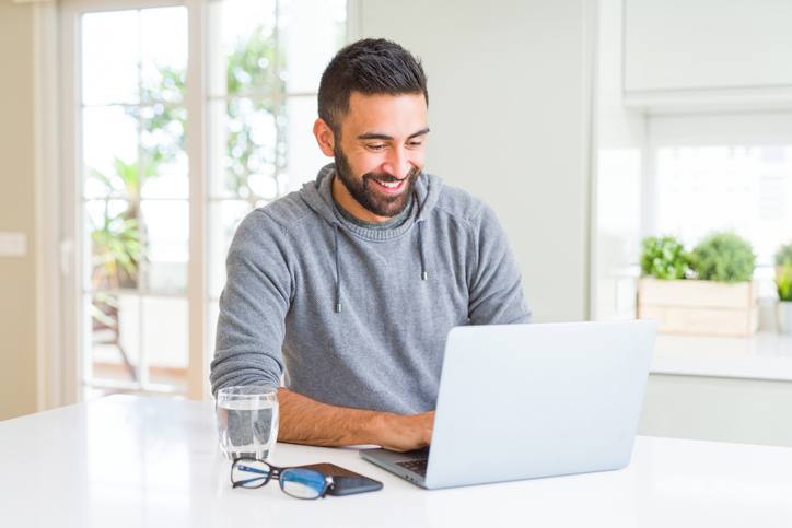 Male is using a laptop computer.