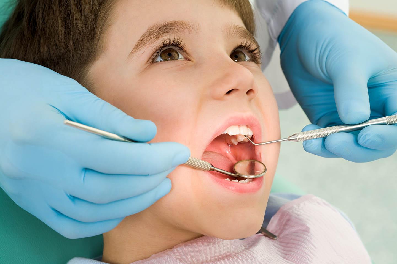child sitting in dentist chair