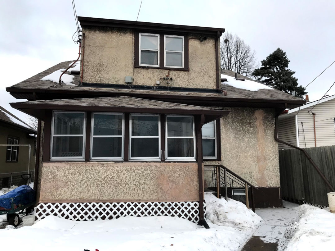 Two story home in snowy minneapolis