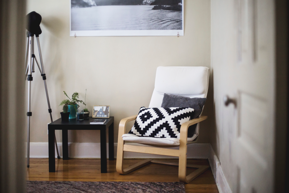 Cozy corner of home with white chair and coffee table