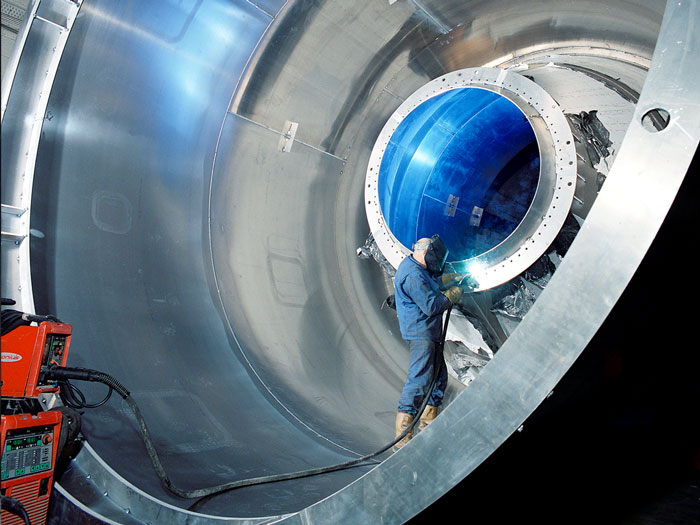 Photography of welding work taking place on the inside of a silo designed and built by Robert Sanderson