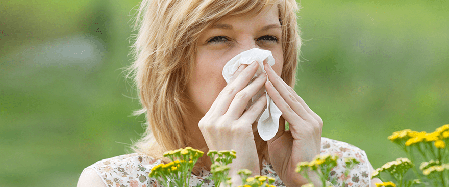 Allergy sufferer outdoors dealing with pollen triggers