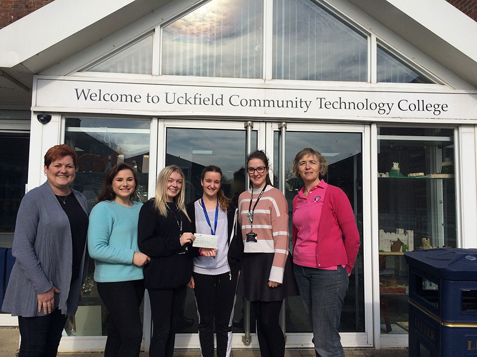 photo receiving a cheque outside Uckfield Community Technology College