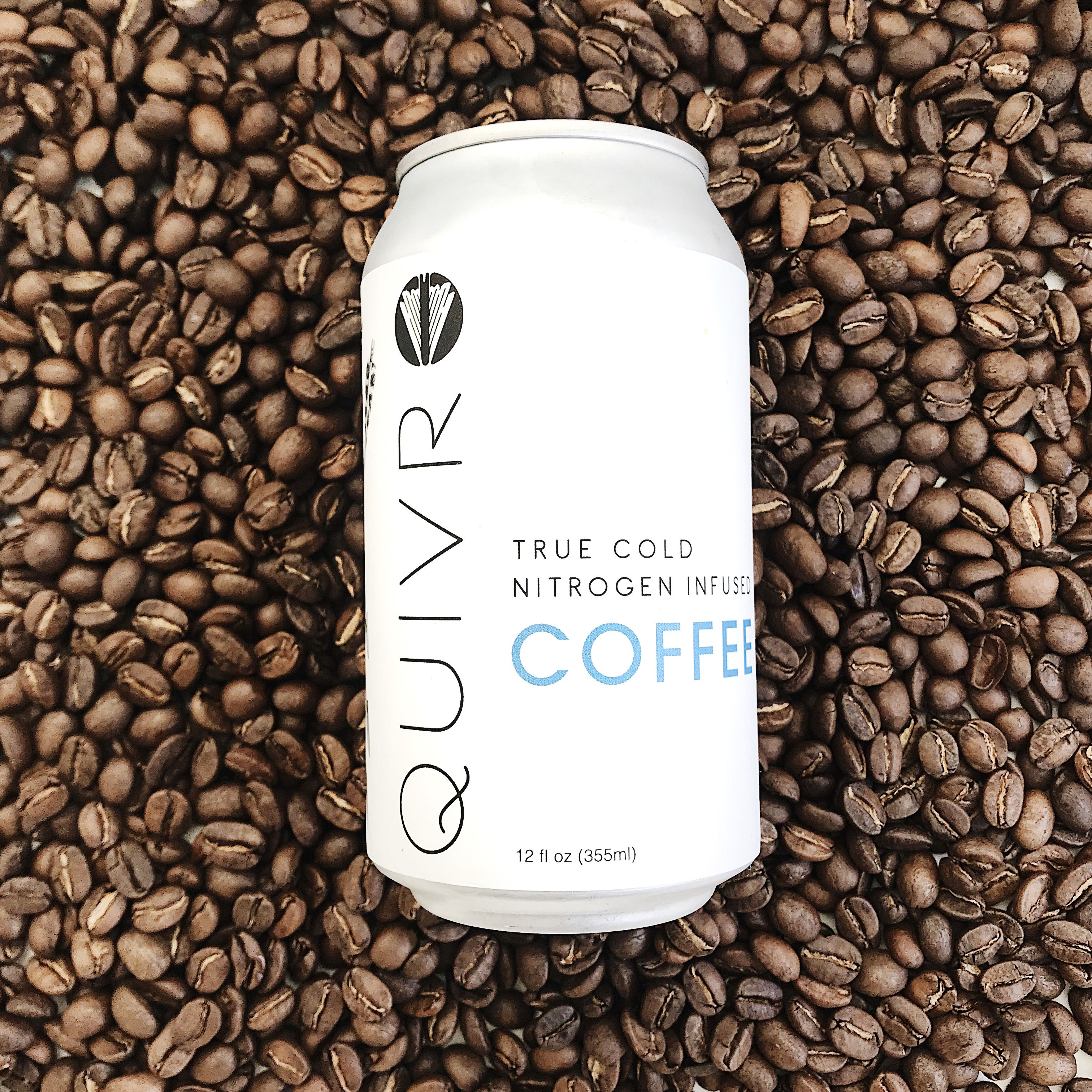 A can of Quivr coffee on a bed of coffee beans