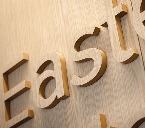 innvendig fasadeskilt med bokstaver i tre