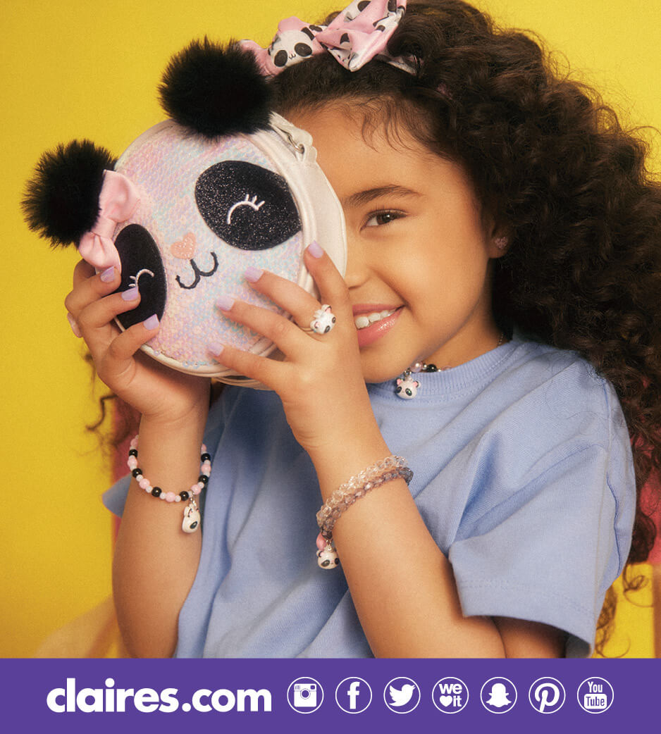 Young girl holding up a Claire's Panda pouch