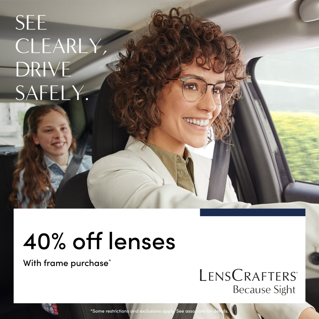 model wearing glasses with a young girl in the back seat of the car