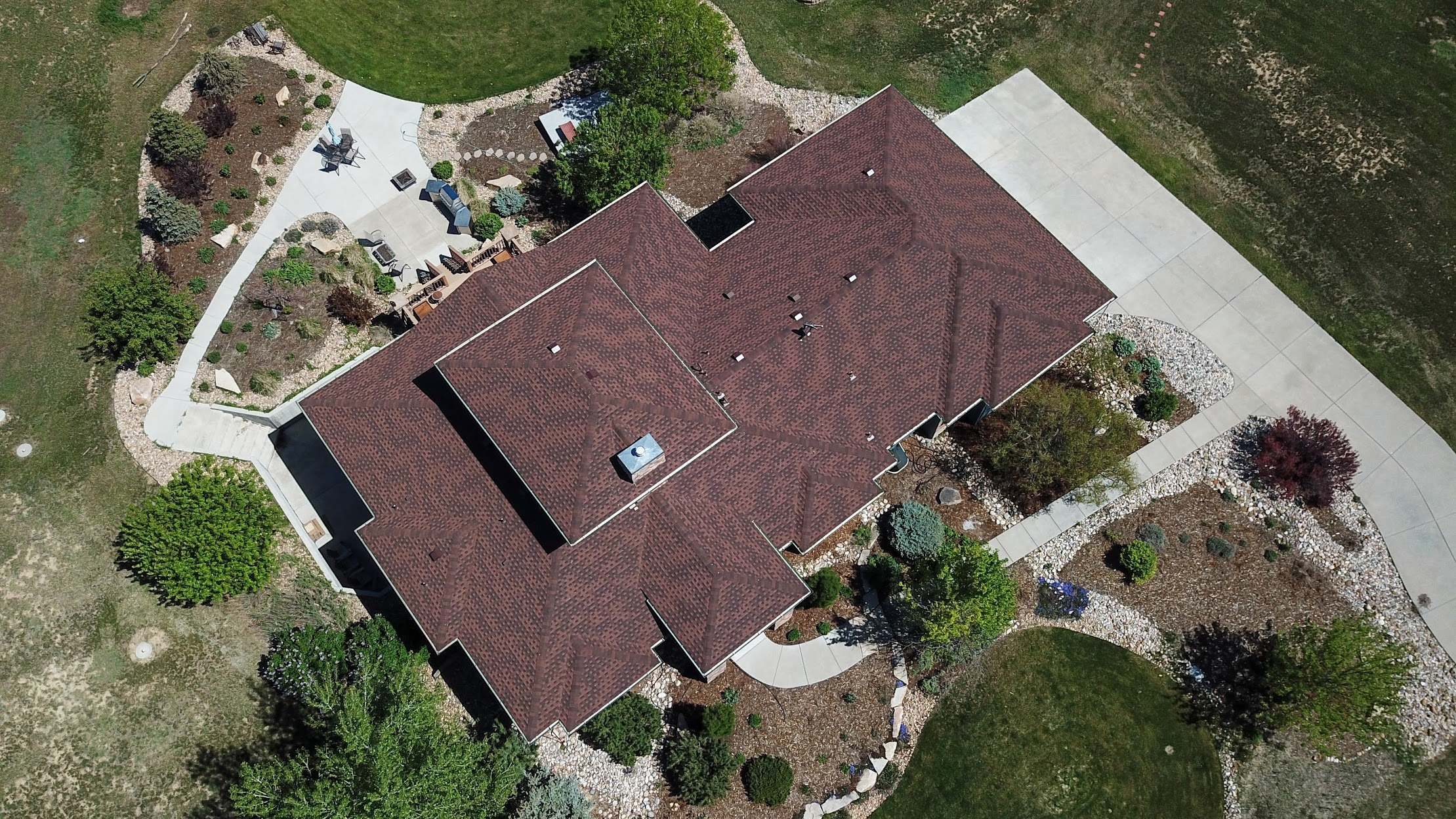 Installed a Residential Reroof with Natural Wood Class IV Shingles and Gutters.