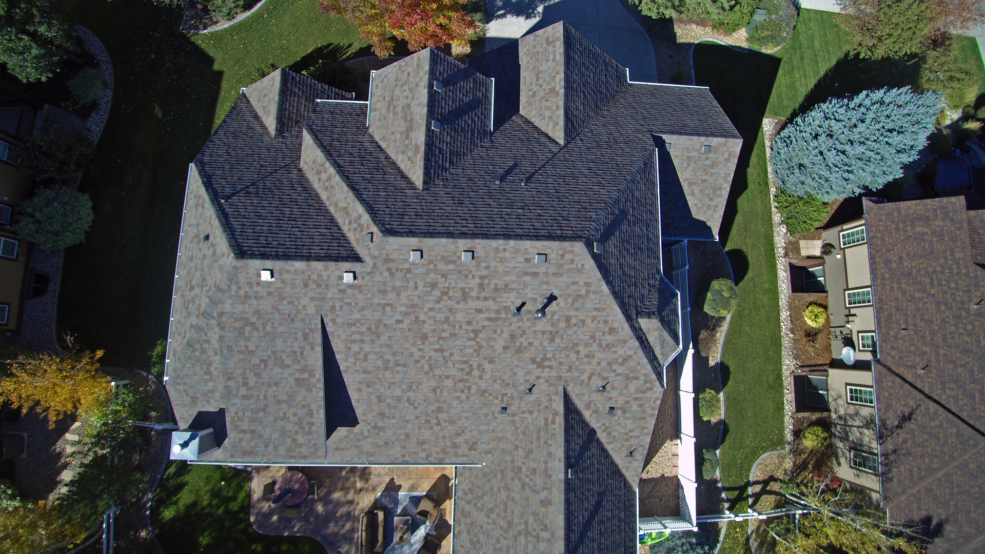 Installed a Residential Reroof with Natural Wood Class IV Shingles.