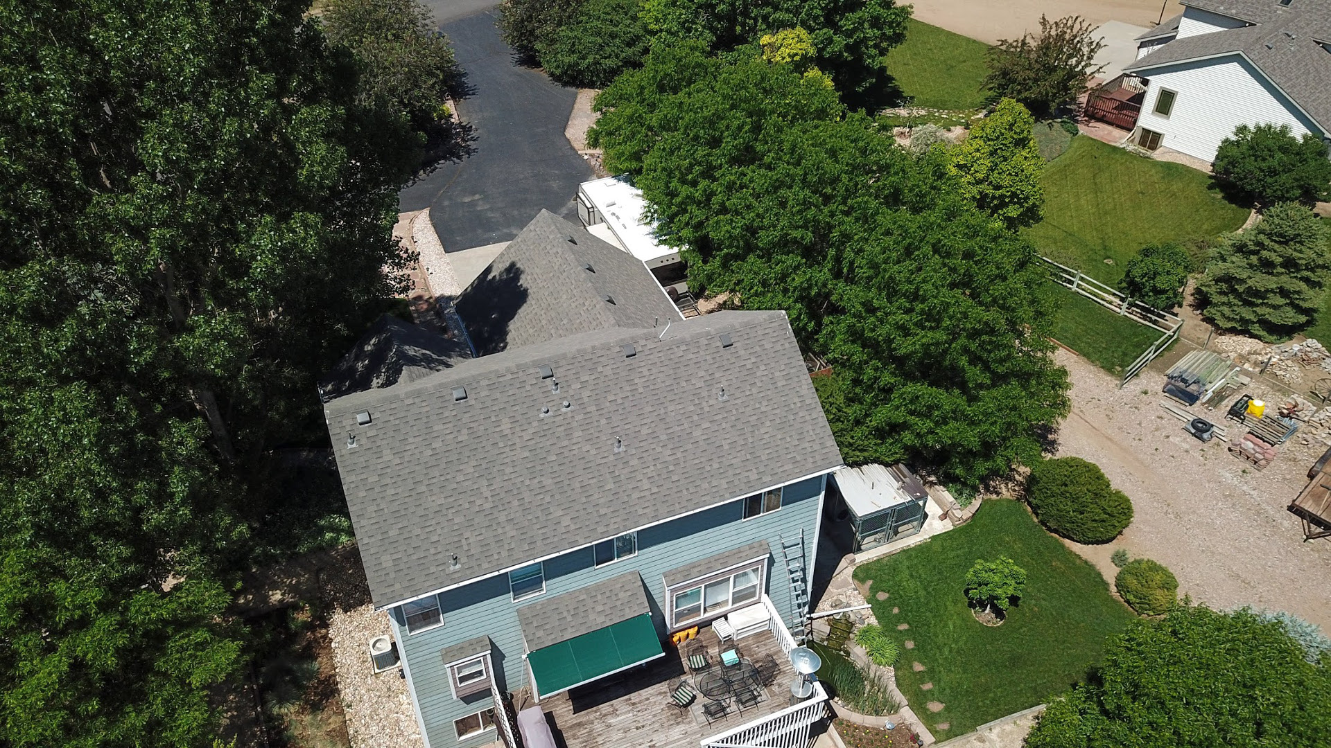 Installed a Residential Reroof with weather wood Class IV shingles, prefinished white gutters.