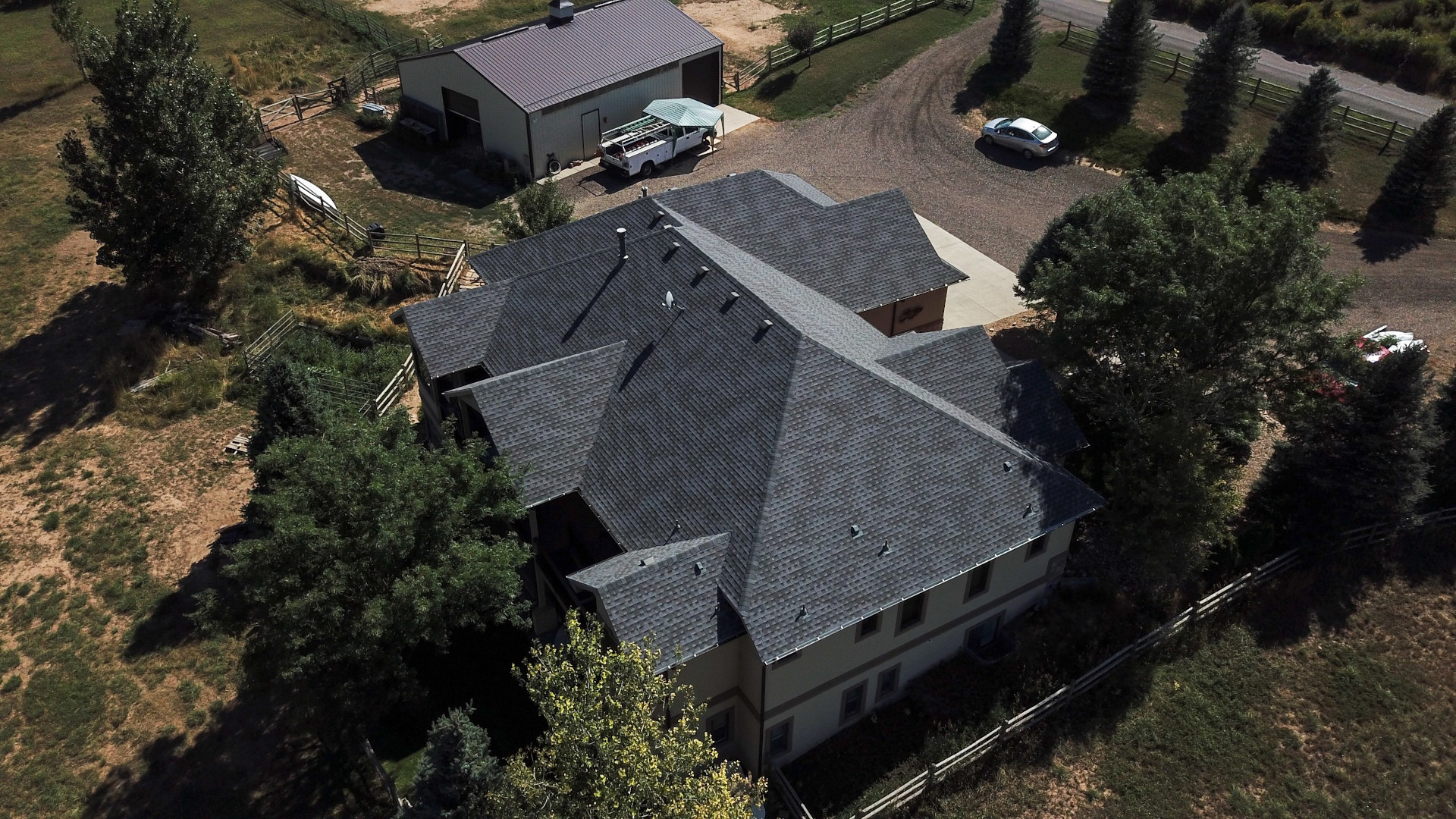 Class IV Shingle Reroof with New Gutters and Downspouts on the main house and adjacent barn.