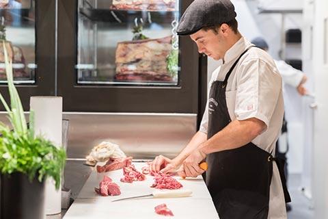 Peter Bouchier butcher chopping beef