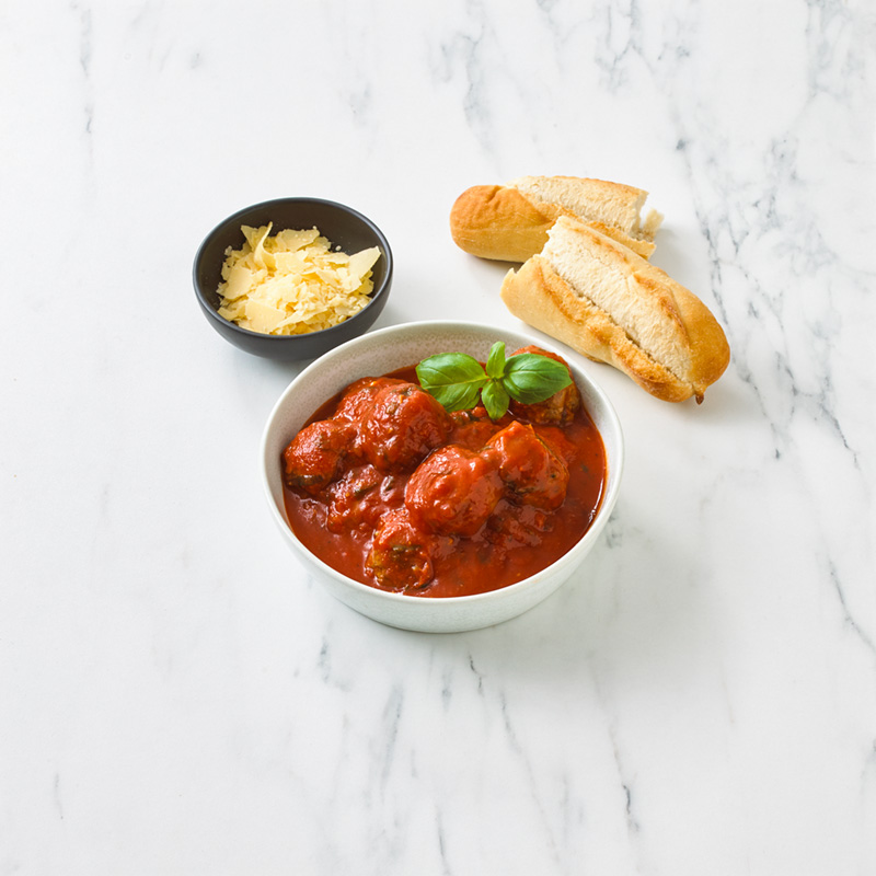 Cooked Gourmet Beef Meatballs in Tomato and Basil Sauce