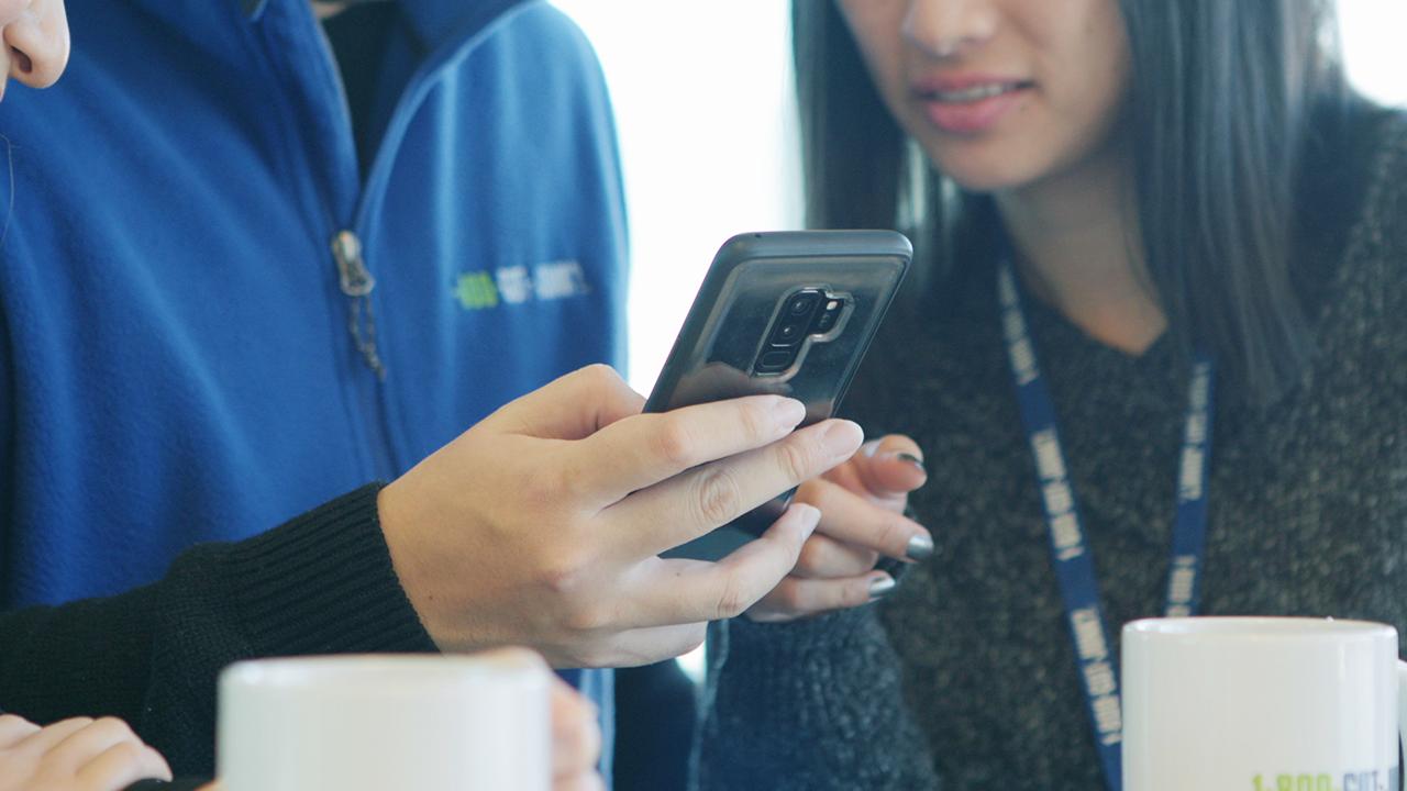 1-800-GOT-JUNK team using business texting