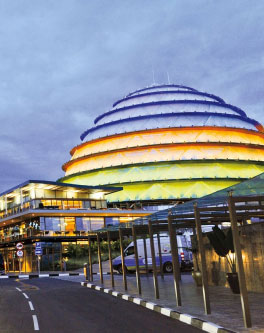 A brightly colored city-center of Kigali at dusk.