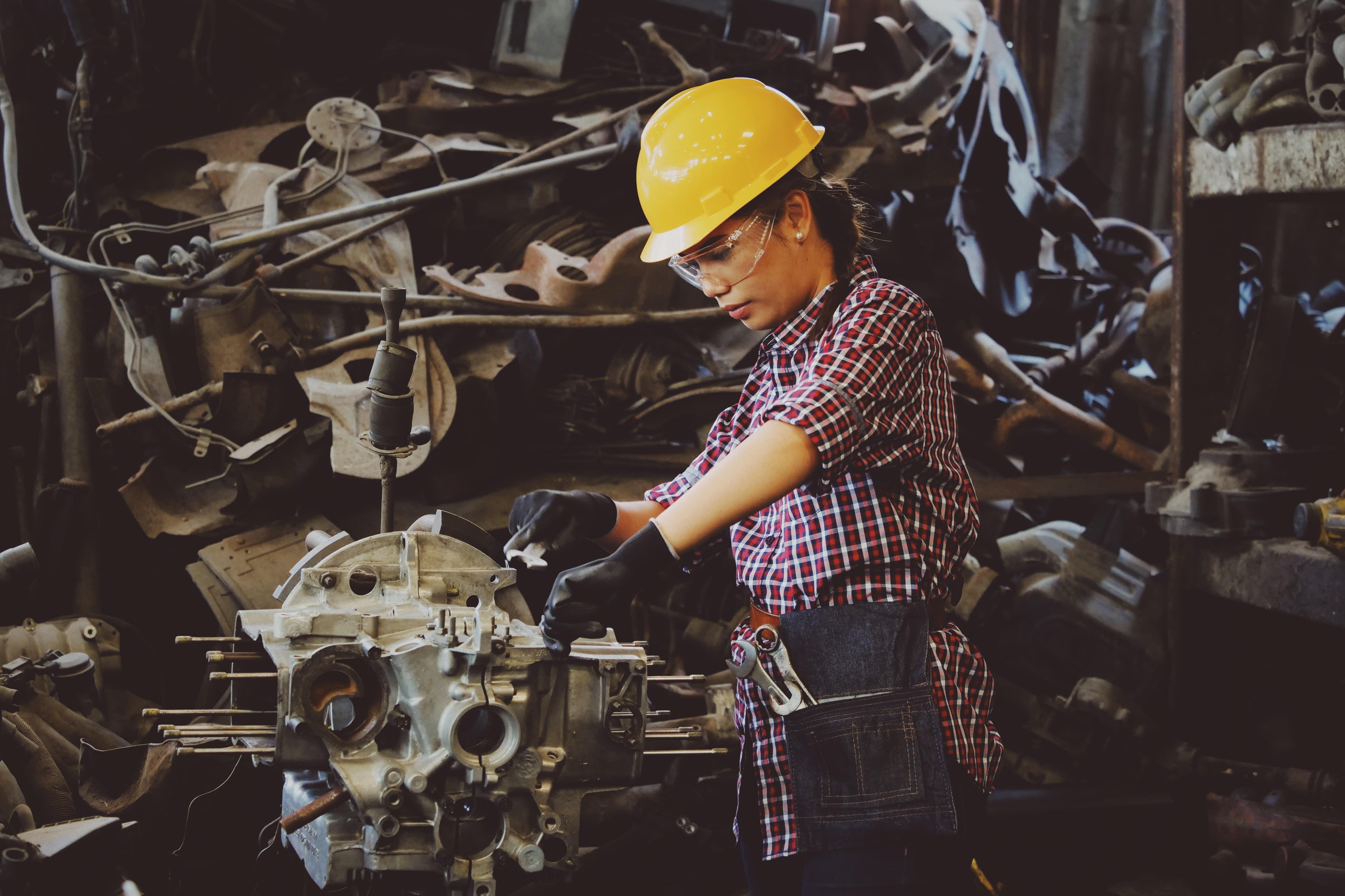 Woman working with a vehicle part