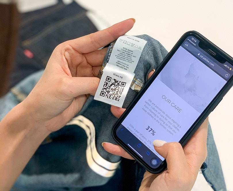Someone using a phone to scan garment care label
