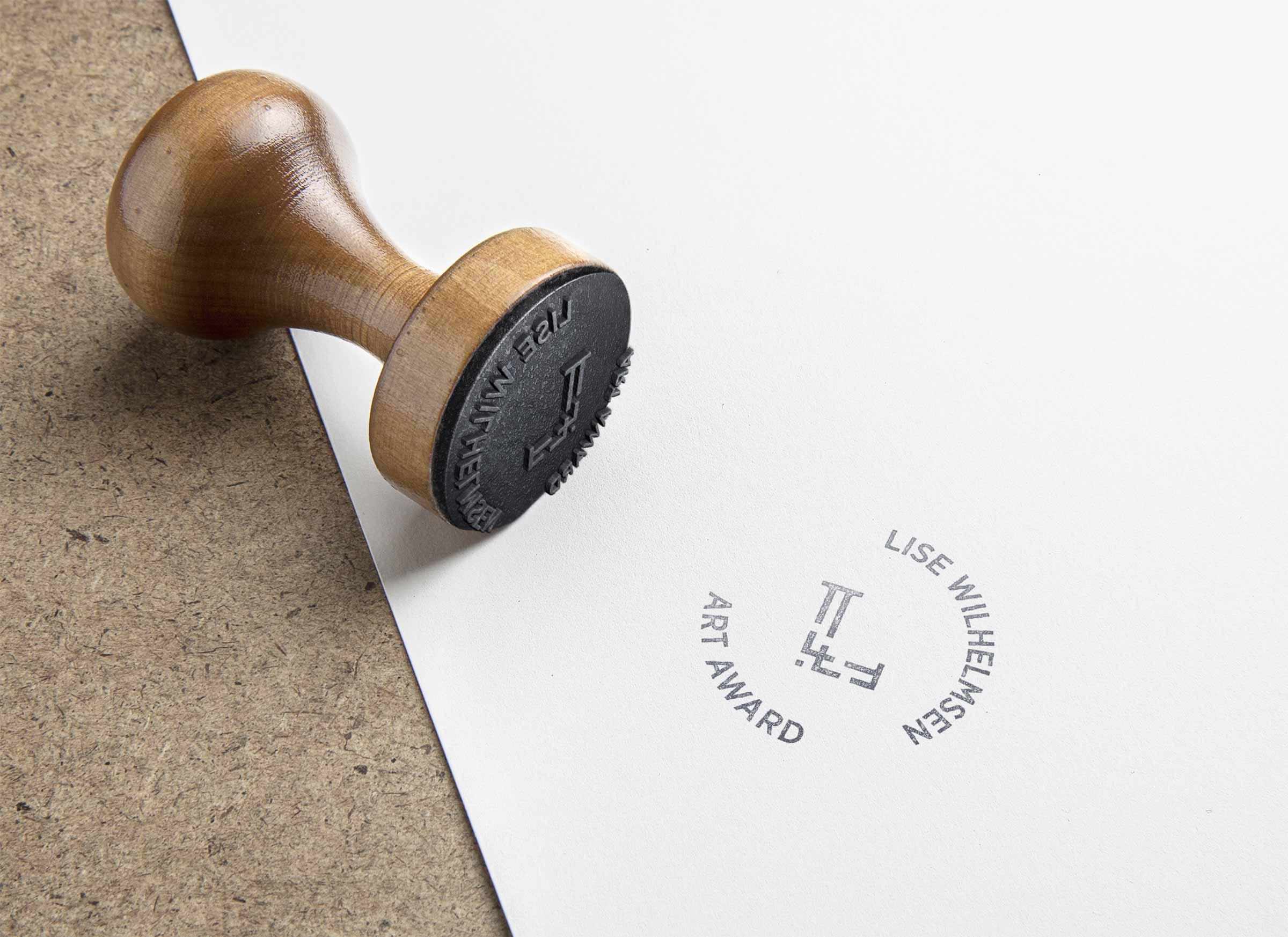 Lise Wilhelmsen Art Award rubber stamp logo, designed by SBDS