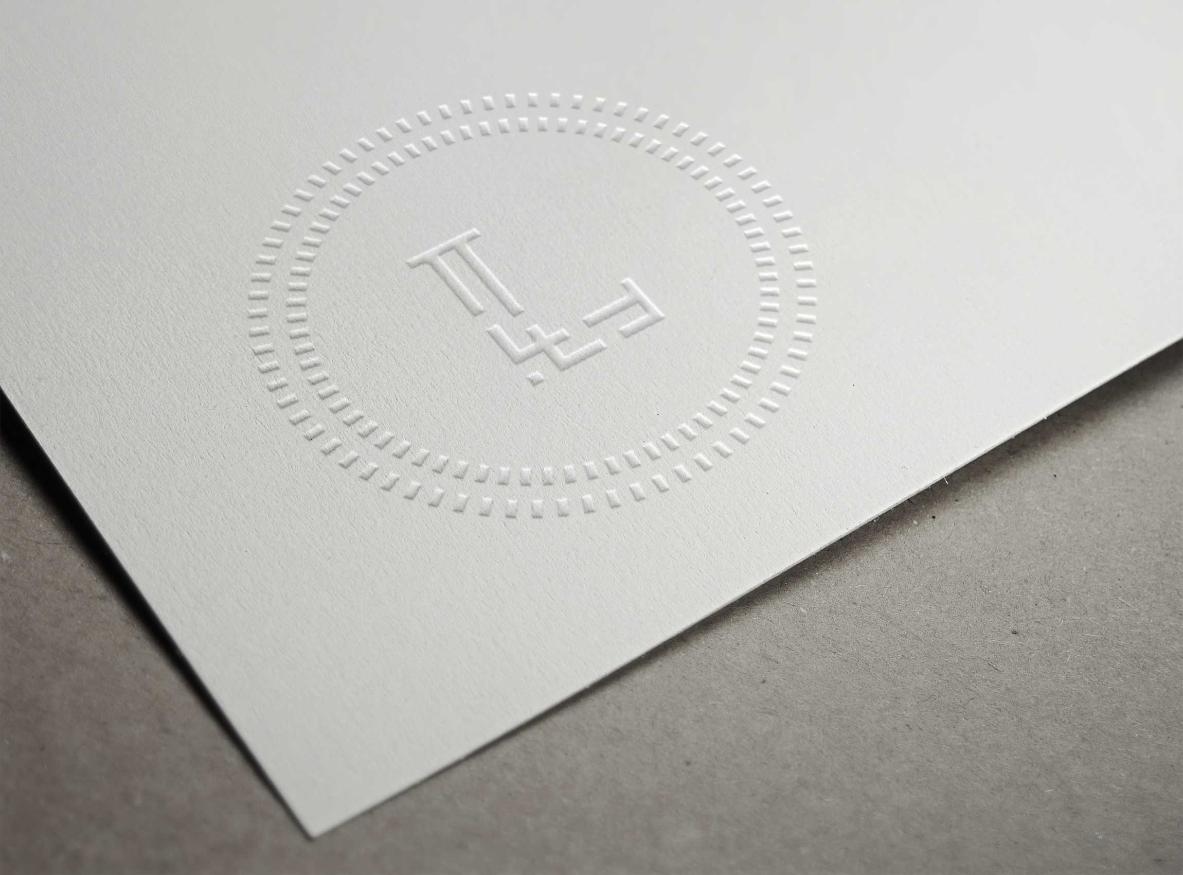 Lise Wilhelmsen Art Award embossed logo, designed by SBDS