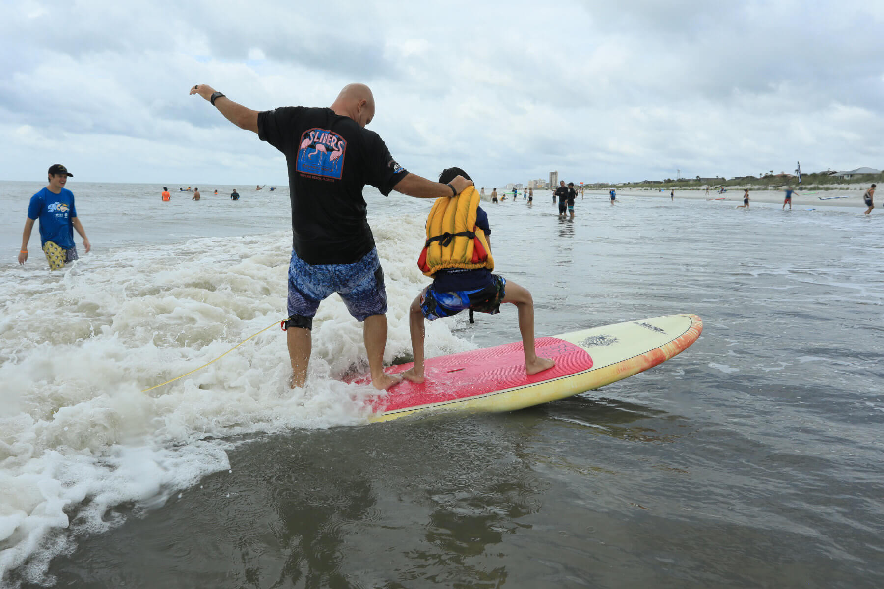 2019 Surf Camp Volunteer and Child Standing
