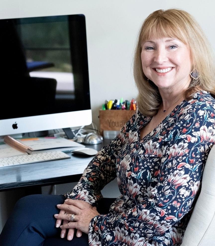 Debbie Collard at her desk