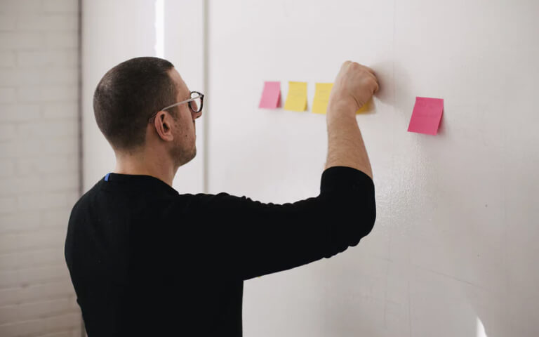 man planning out projects