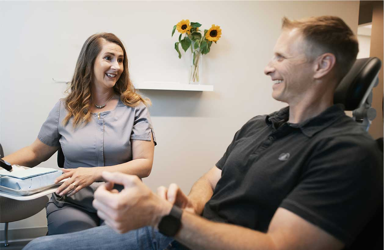 Photo of a team member talking with a patient