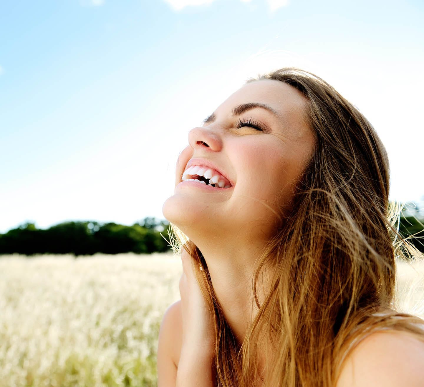 smiling woman in field