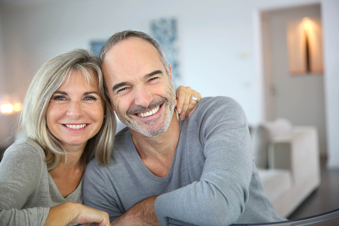 smiling middle age couple