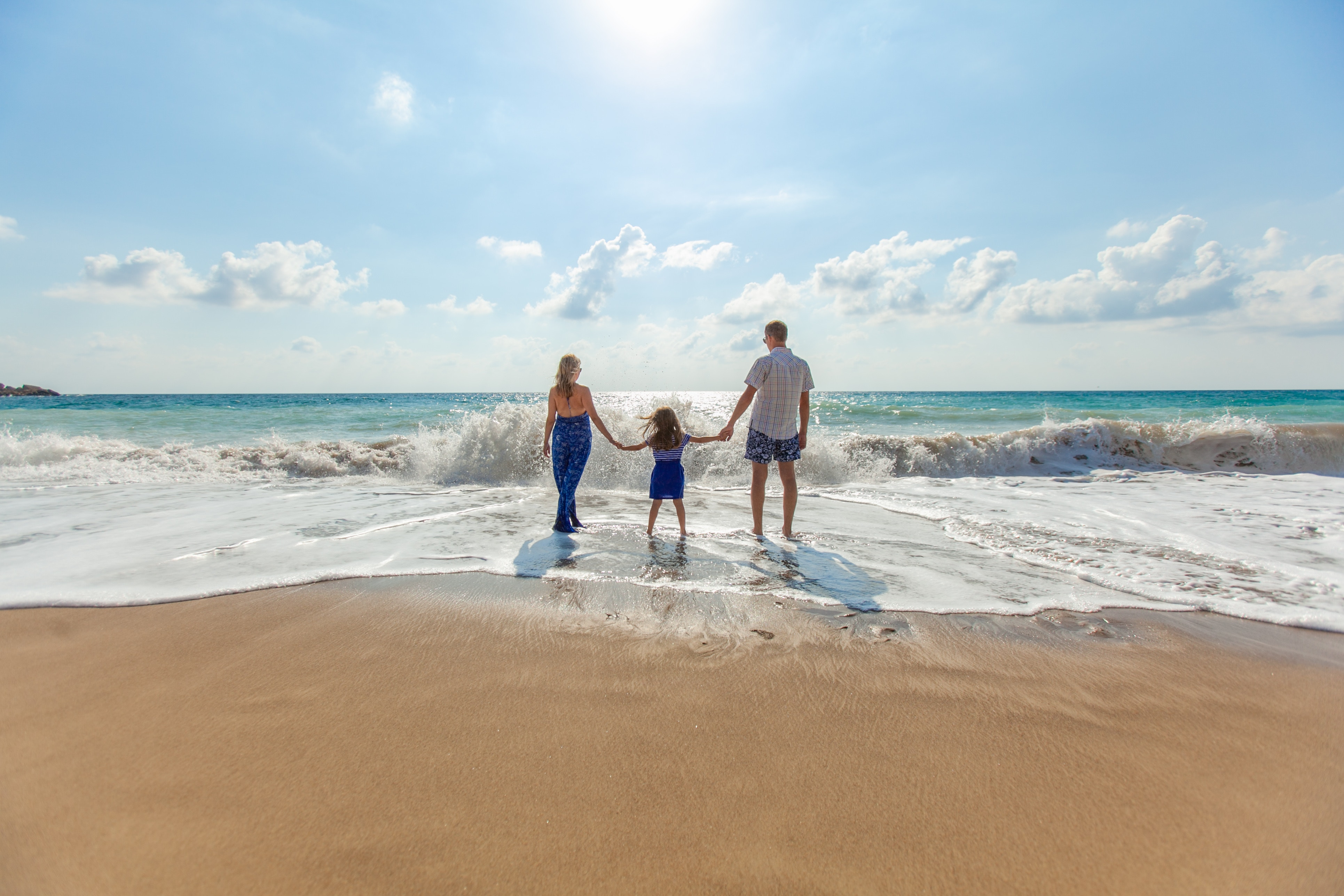 Family of three at the beach
