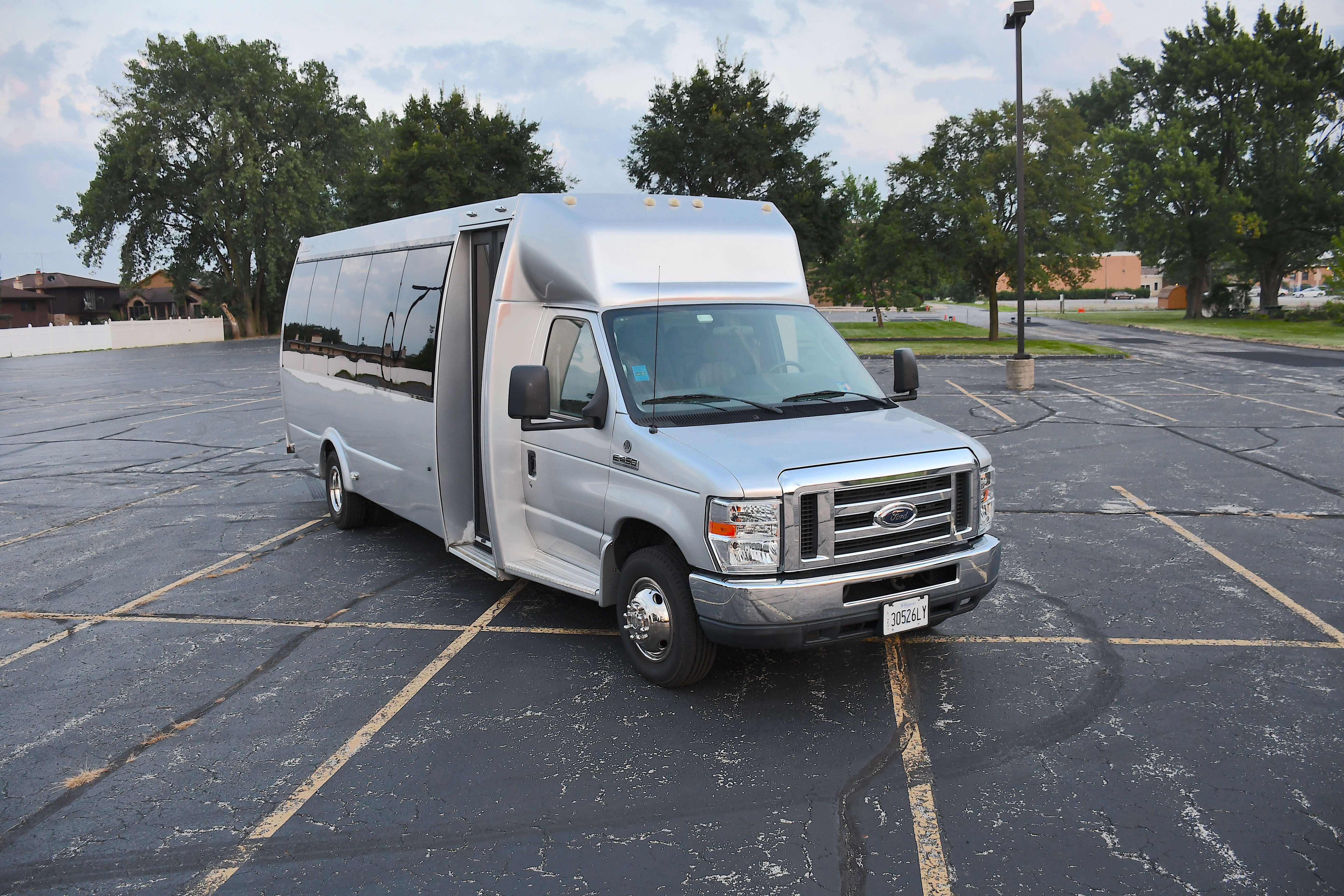 Silver bus provided by A Stars Limo