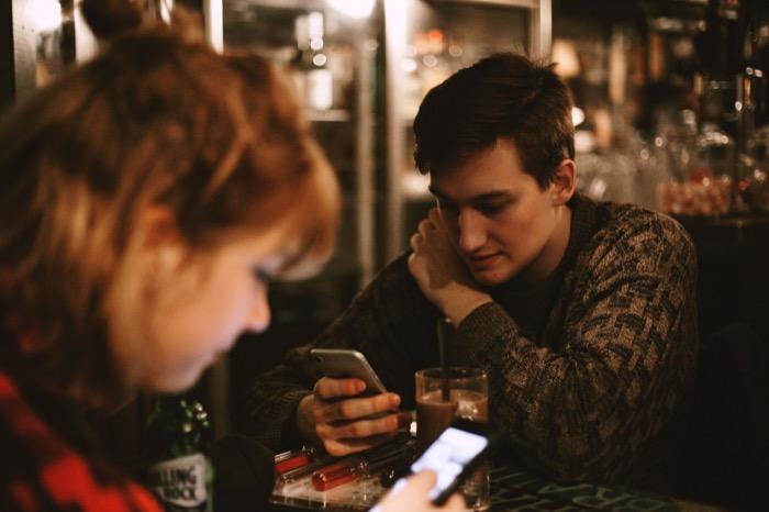 Referral Program - friends using phones