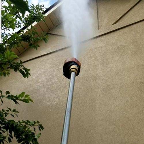 residential power washing a home in thornton