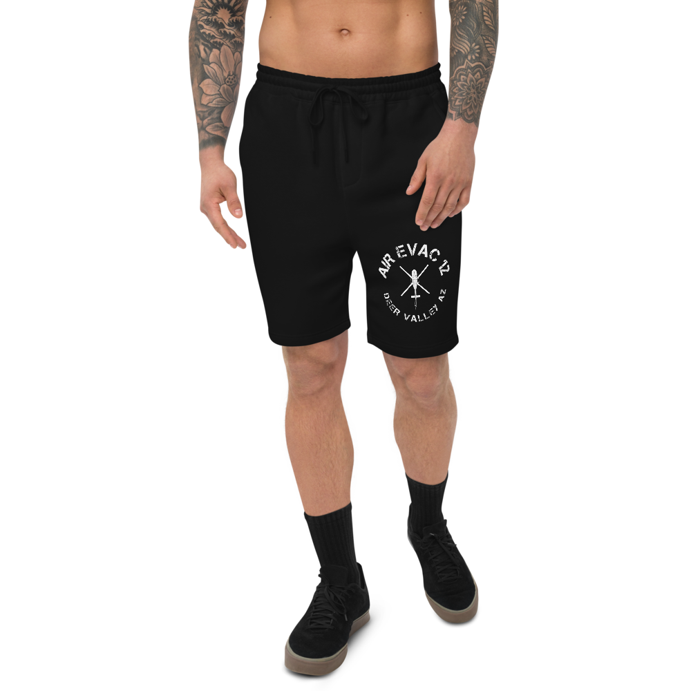 The men's fleece shorts are soft, comfy, and great for lounging indoors or going out. The shorts have 1 back pocket, 2 jersey-lined hand pockets, and an elastic waistband with a shoestring drawcord.  • 80% ring-spun cotton, 20% Polyester • Grey Heather is 52% ring-spun cotton and 48% polyester • 100% cotton face yarn • 32 singles • Fabric weight: 8.5 oz/yd² (280 g/m²) • Relaxed fit • Sewn eyelets • Sewn fly detail • Elastic waistband with shoestring drawcord • Back pocket  • Jersey-lined hand pockets • Tapered knee opening