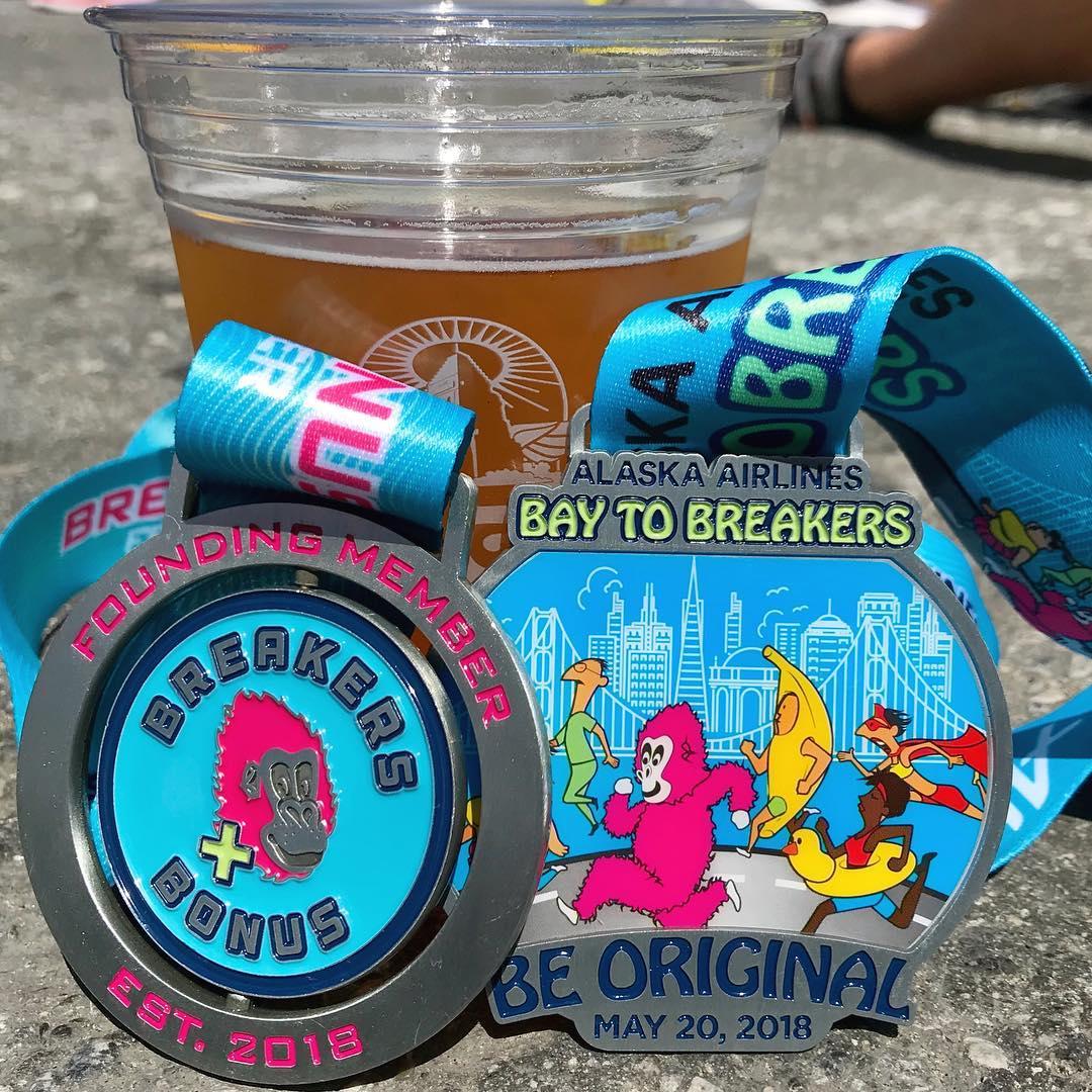 Breakers Bonus Medal beside Alaska Airlines Bay to Breakers Medal