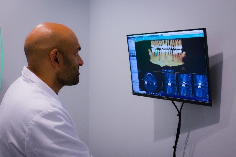 Dentist looking at x-ray