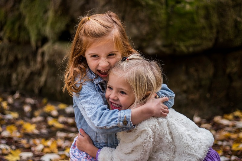 little girls hugging outside