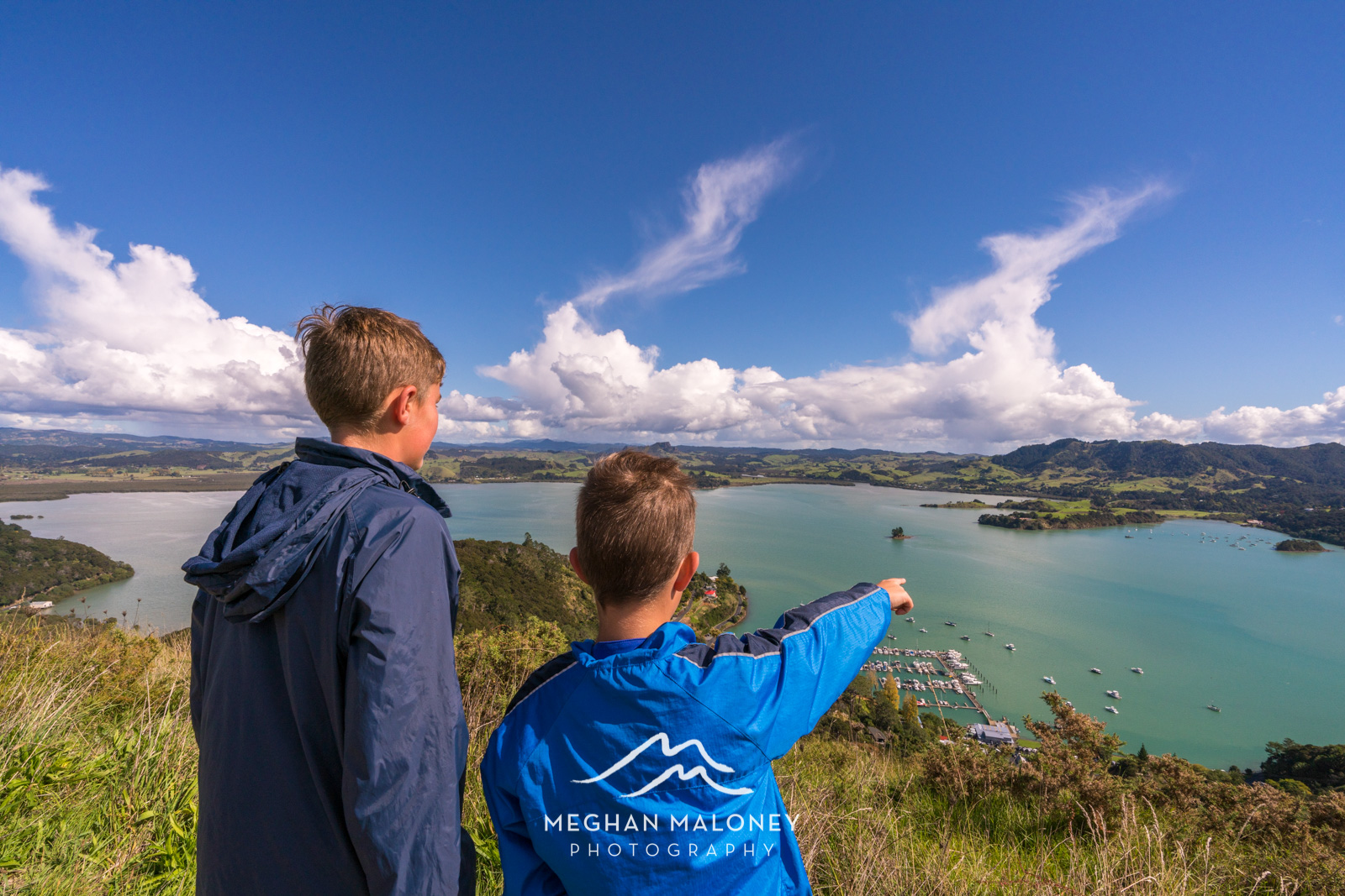 Boys looking over Whangaroa Harbour