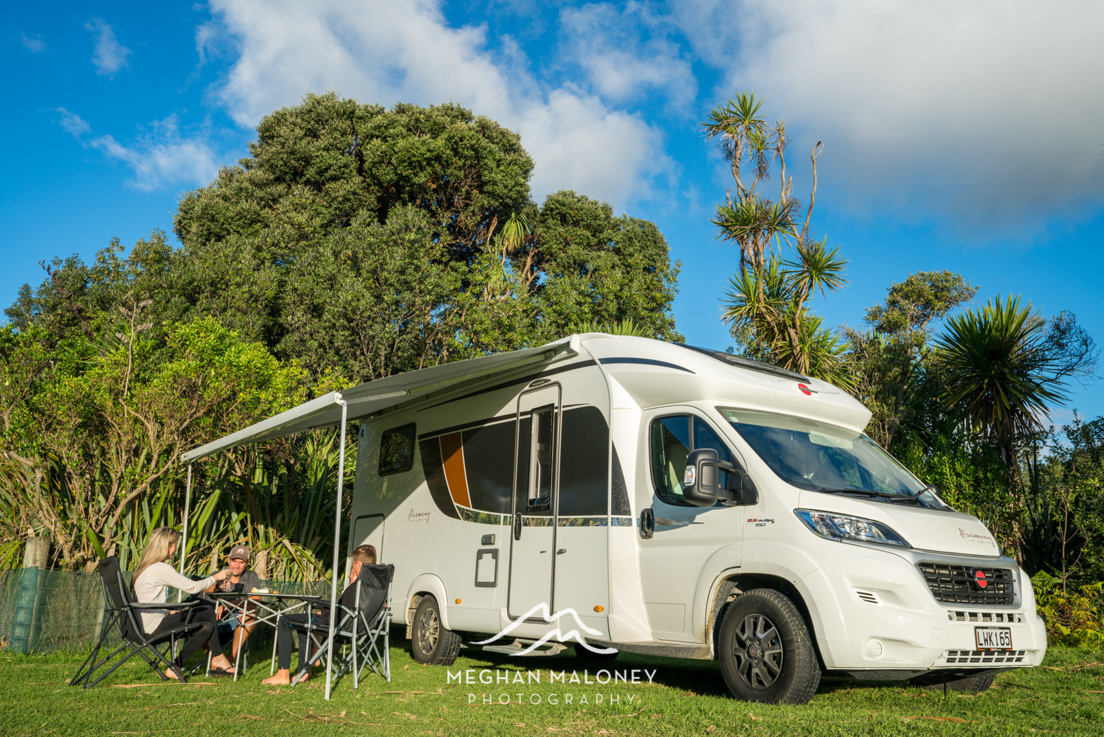 Relaxing outside Wilderness NZ Alpine 4 motorhome