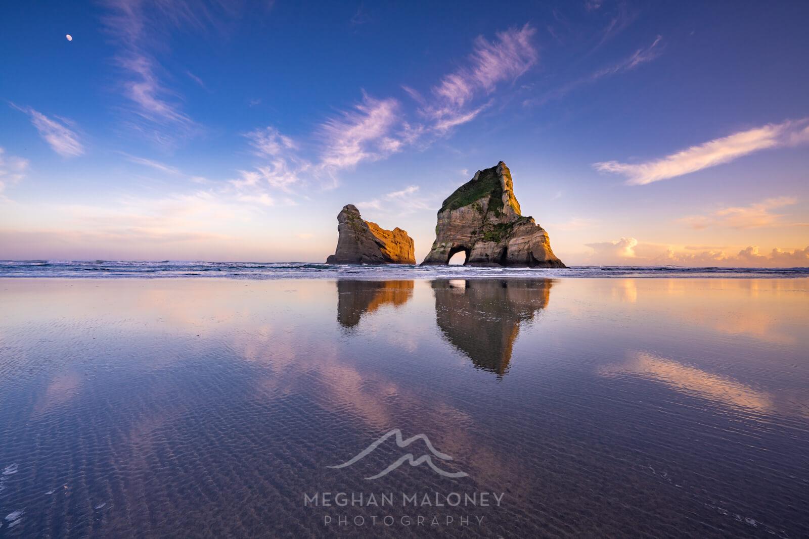 wharariki beach reflection