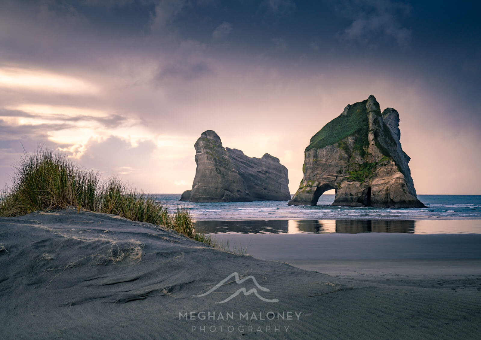 wharariki beach sunset light