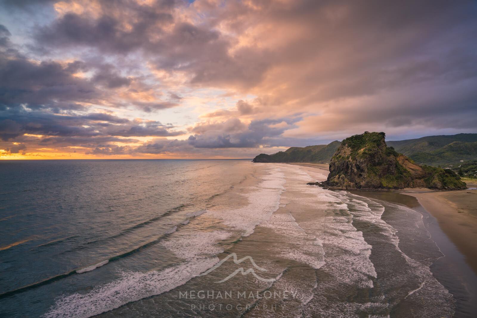 piha beach golden sunset