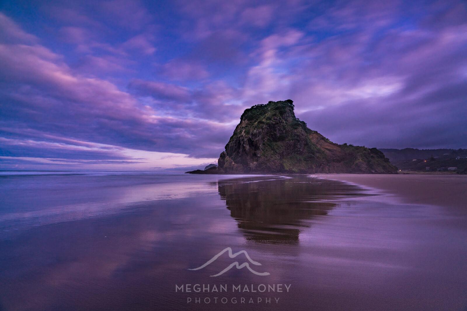 piha beach sunrise reflection