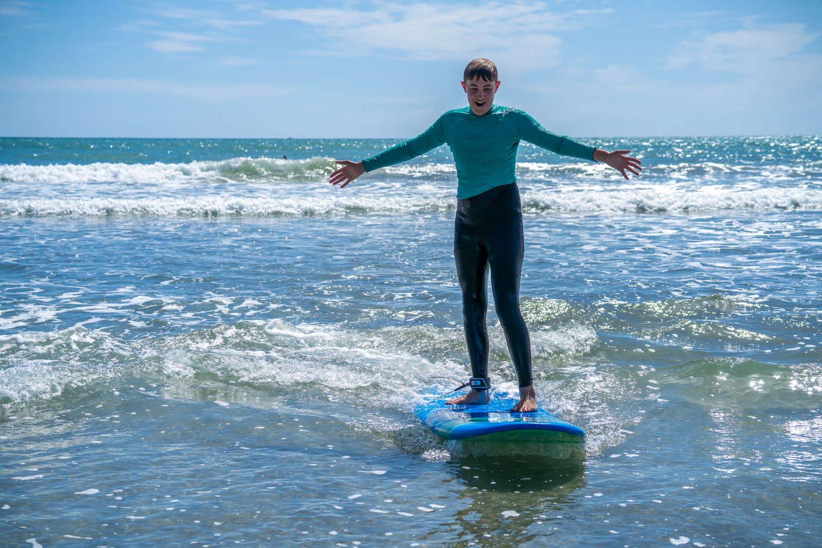 Catching waves at Ohope's West End