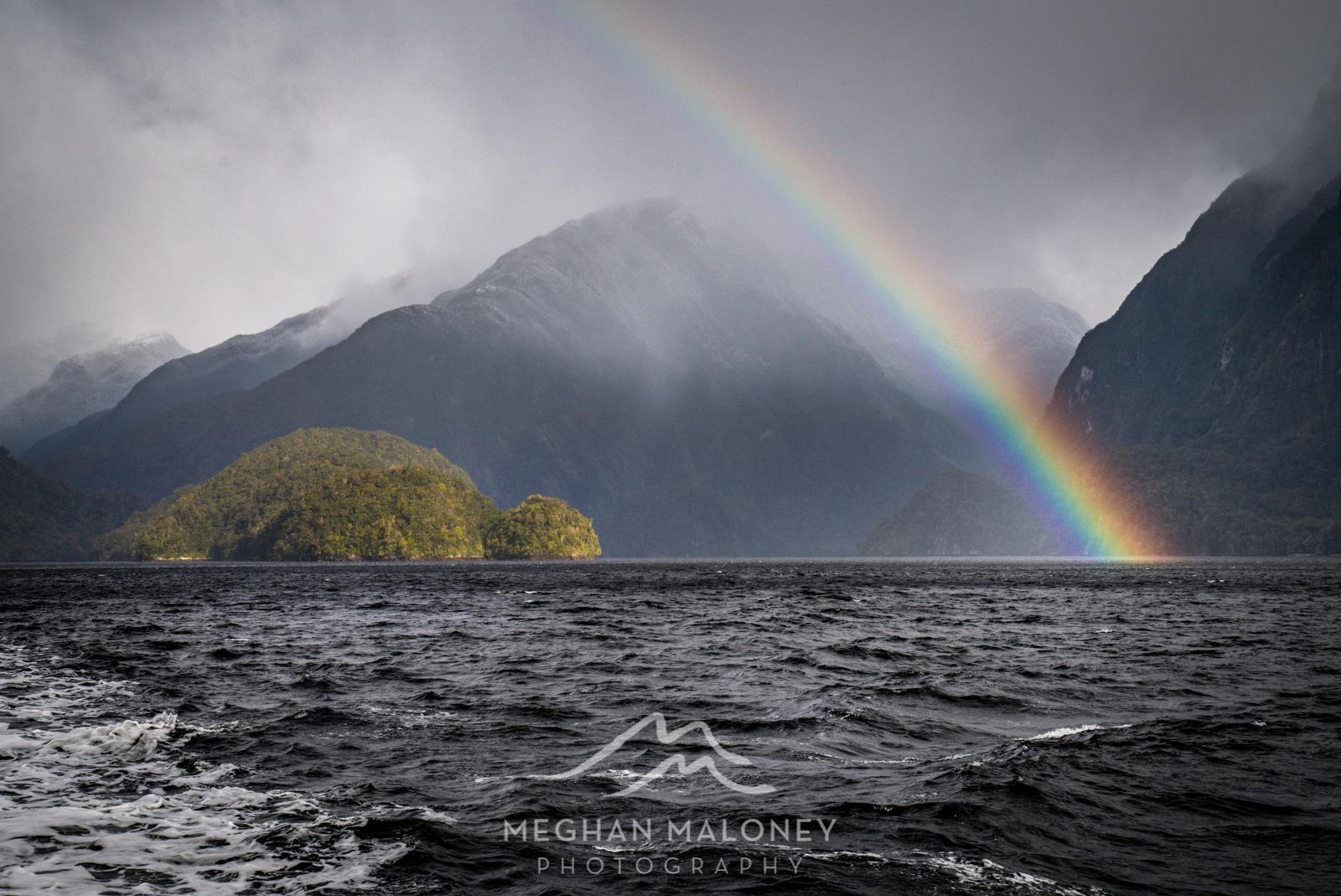 rainbow over island doubtful sound