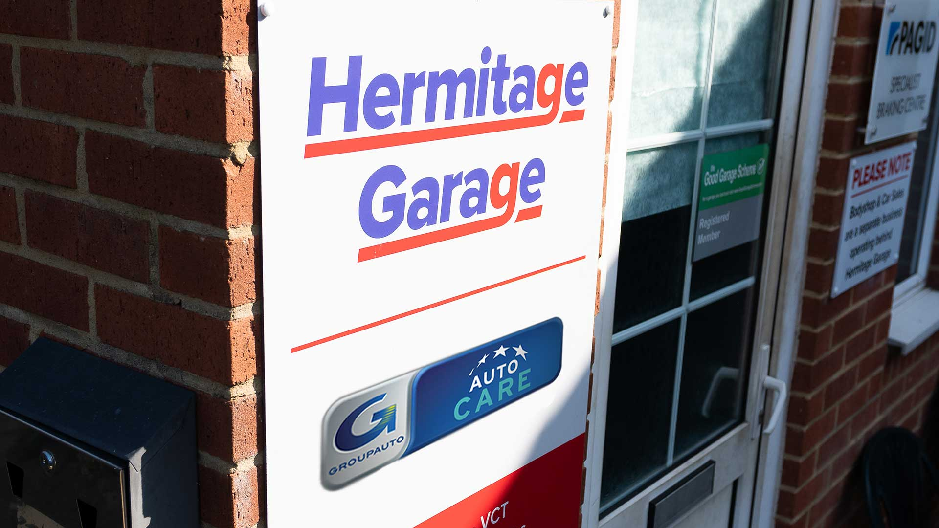 Photo of the Hermitage Garage shop sign