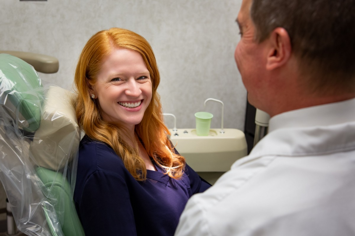Smiling patient with Dr. Morrison